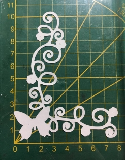 Scrapbooking découpe coin arabesque papillon