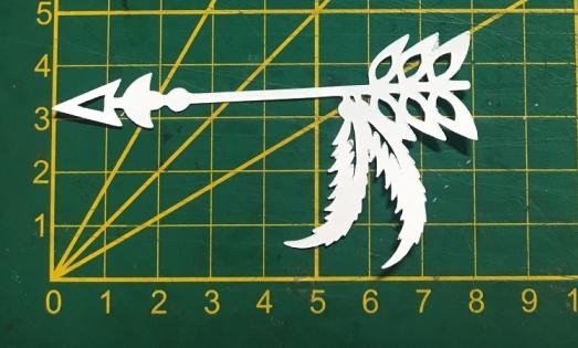 Scrapbooking découpe fléche avec plume