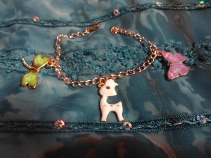 Bracelet or rose et ses trois breloques d'animaux